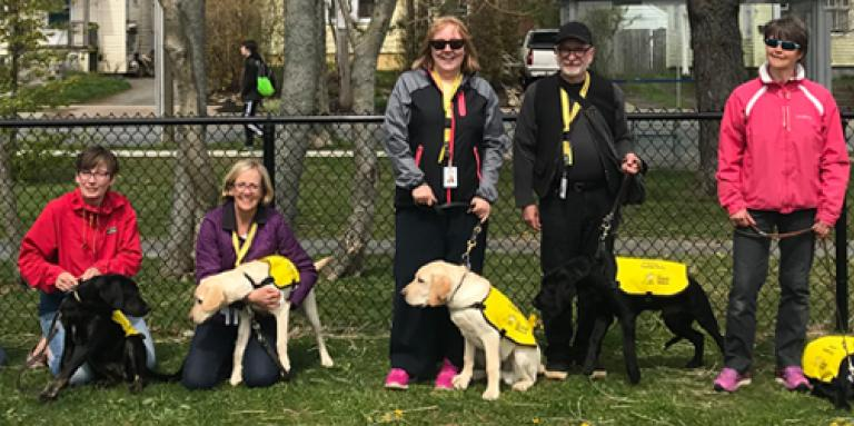 CNIB guide dog handlers with their puppies