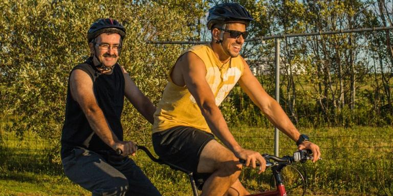 A CNIB volunteer and participant out for a spin on a tandem bike